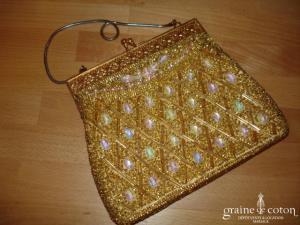 Petit sac doré, porté main