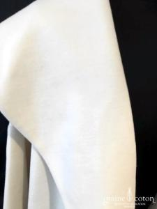 Delphine Manivet - Manteau mi long en laine ivoire, dos au point de croix