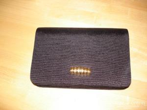 Pochette noire et dorée